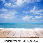 wood table with sea background | Shutterstock . vector #311658563