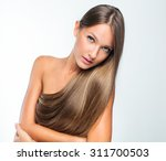 beautiful woman with healthy... | Shutterstock . vector #311700503