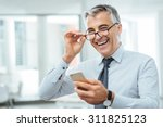 Smiling Businessman With...