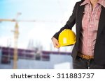 engineer holding yellow helmet... | Shutterstock . vector #311883737