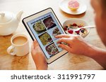 person at breakfast looking at... | Shutterstock . vector #311991797