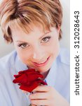 Young Woman Holding Red Rose...