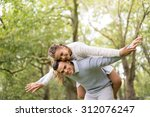 a couple walking in the hyde... | Shutterstock . vector #312076247