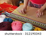 woman hands weaving a handmade... | Shutterstock . vector #312190343