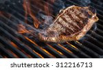 ny strip steak on grill | Shutterstock . vector #312216713