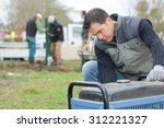 Small photo of Builder turning on an air compressor