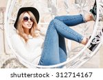 beautiful young girl resting in ...   Shutterstock . vector #312714167