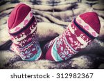 female legs in christmas socks... | Shutterstock . vector #312982367
