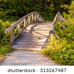 Wooden Bridge In A Park...