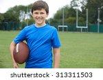 portrait of boy holding ball on ... | Shutterstock . vector #313311503