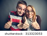 happy nerdy couple showing... | Shutterstock . vector #313323053