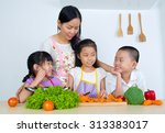 asian mother and children... | Shutterstock . vector #313383017