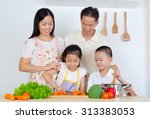 asian family in the kitchen | Shutterstock . vector #313383053