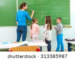 teacher and student at the... | Shutterstock . vector #313385987