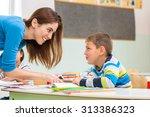 female teacher shows the... | Shutterstock . vector #313386323