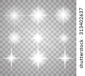 set of glowing light stars with ... | Shutterstock .eps vector #313402637
