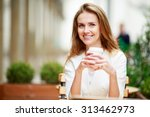 woman drinking coffee at street ... | Shutterstock . vector #313462973