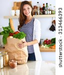 young woman holding grocery... | Shutterstock . vector #313466393