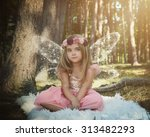 a little girl is sitting in the ... | Shutterstock . vector #313482293