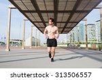 purposeful male runner engaged... | Shutterstock . vector #313506557
