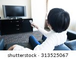 men watching television in the... | Shutterstock . vector #313525067