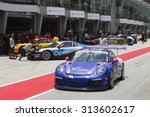 Small photo of Sepang, Malaysia - September 5, 2015 : Malaysian Alif Hamdan of Team Alif Hamdan exits pitlane at Porsche Carrera Cup Asia AFOS, Sepang, Malaysia