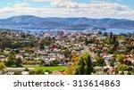 Aerial view of Hobart City. Large cruise ship is docked over horizon. Hobart City, Tasmanian Island. Australia.