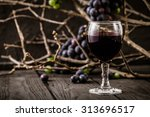Red Wine With Grapes. Fresh...