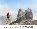 young woman crossing the chasm... | Shutterstock . vector #313716887