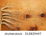 old wood table with spikelets... | Shutterstock . vector #313835447