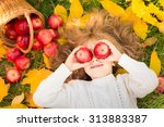 Happy Child Lying On Fall...