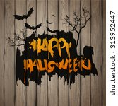 happy halloween painted on... | Shutterstock .eps vector #313952447