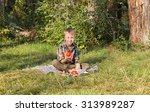boy in nature eating tomato | Shutterstock . vector #313989287