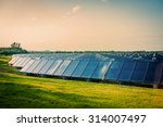 solar park with blue cells on a ... | Shutterstock . vector #314007497