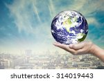 planet in hand with downtown... | Shutterstock . vector #314019443