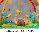 child playing lying in mobile | Shutterstock . vector #314023067