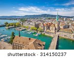 Aerial view of historic Zurich city center with famous Fraumunster Church and river Limmat at Lake Zurich from Grossmunster Church on a sunny day with clouds in summer, Canton of Zurich, Switzerland