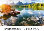 boat on the dock surrounded... | Shutterstock . vector #314154977