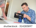 carpenter setting up a circular ... | Shutterstock . vector #314285897