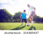 little boy playing soccer with... | Shutterstock . vector #314385437