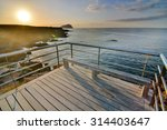 Stock photo sunrise on a pier over atlantic ocean in tenerife canary islands spain 314403647