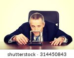 Mature Businessman In Office...