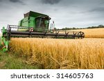combine harvester at work... | Shutterstock . vector #314605763