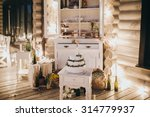 a white wedding cake decorated... | Shutterstock . vector #314779937