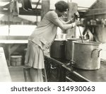 Woman Working In Soup Kitchen