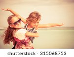 sister and brother playing on... | Shutterstock . vector #315068753