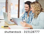 man showing laptop to woman... | Shutterstock . vector #315128777