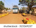 Small photo of Dilla, Ethiopia - February 23, 2015: Truck travelling in Africa is getting water supplied in small town of Dilla in Ethiopia.
