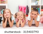 row of children on floor in... | Shutterstock . vector #315403793