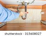 Plumber Is Repairing A Leaky...